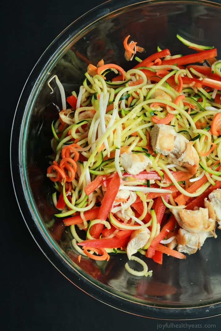 Zoodles are the star in this easy 15 minute Thai Chicken Zucchini Noodles recipe with Spicy Peanut Sauce only 363 calories and packed with a punch of flavor!   joyfulhealthyeats.com #paleo #glutenfree