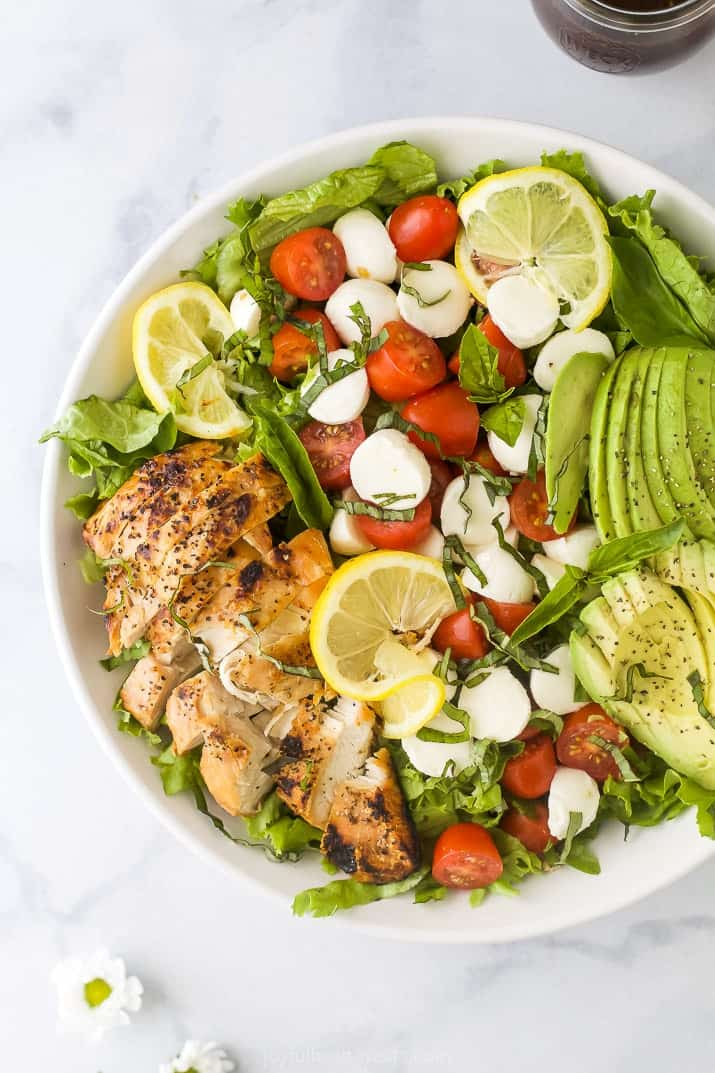 overhead photo of avocado caprese chicken salad in a bowl