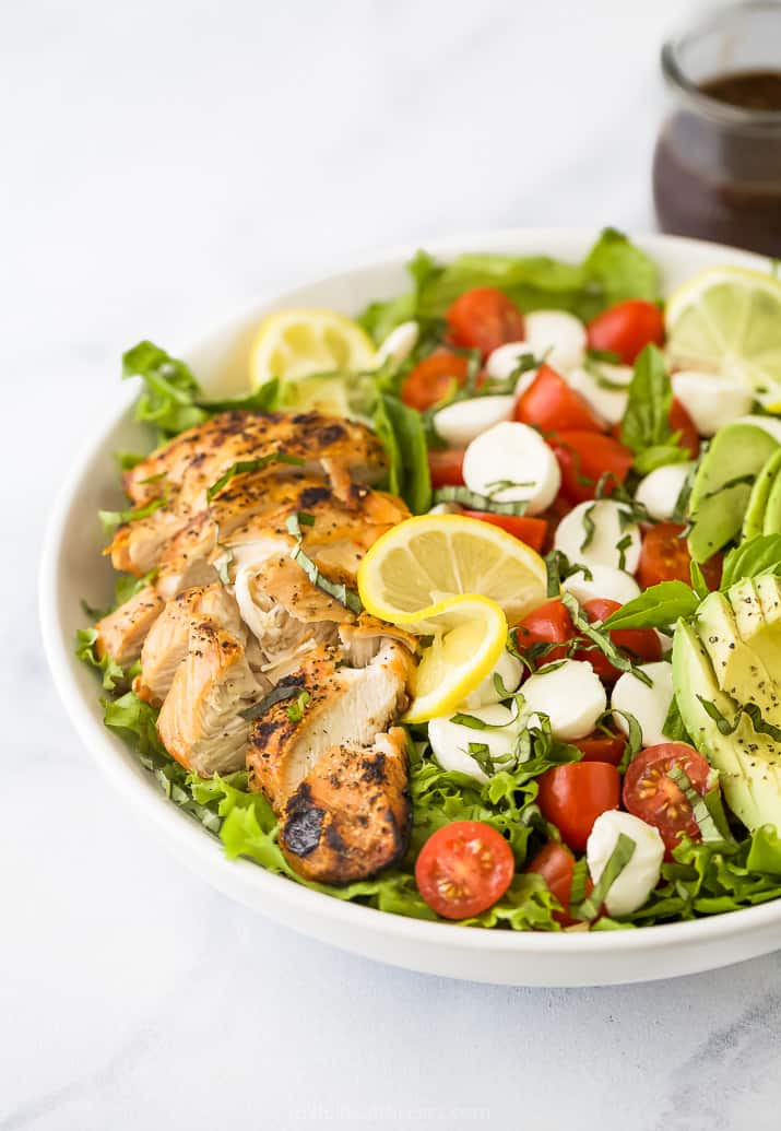 side photo of avocado caprese chicken salad in a bowl