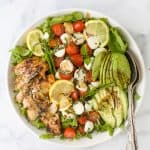 overhead photo of avocado caprese chicken salad with balsamic vinaigrette