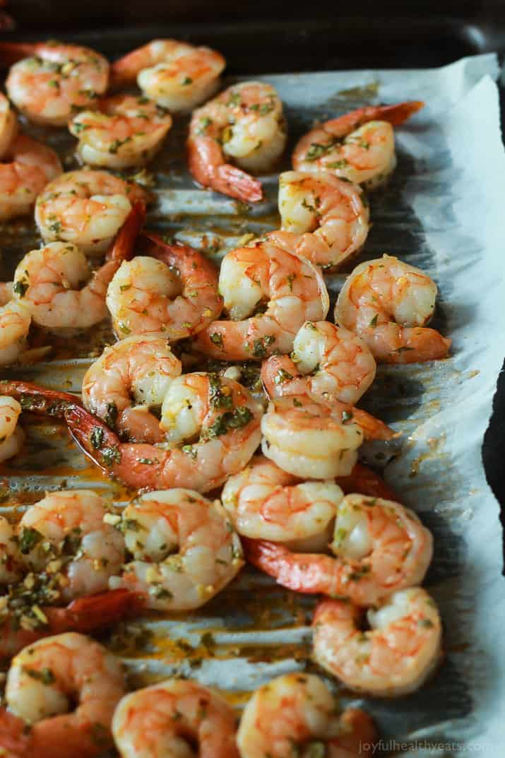 Cilantro Lime Roasted Shrimp on a parchment-lined baking sheet