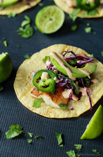 The BEST Grilled Mahi Mahi Fish Tacos you will ever have. Topped with crunchy purple cabbage, avocados, and a drizzle of Chipotle Lime Crema - all wrapped in a warm tortilla! All in under 20 minutes!   joyfulhealthyeats.com #recipes #grillseason