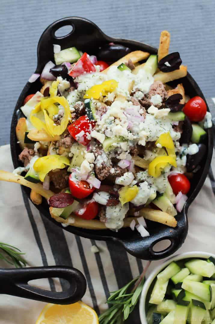 Skinny Greek Loaded French Fry Nachos, an easy creative appetizer recipe that will wow your guests and only takes 25 minutes to make! Filled with homemade tzatziki sauce, ground lamb, and fresh vegetables! | joyfulhealthyeats.com #recipes #SpringIntoFlavor #ad