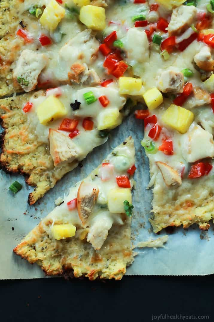Thai Chili Chicken Pizza with a Cauliflower Crust, topped with a Sweet Spicy Thai Chili Sauce, fresh pineapple, bell peppers, and chicken. An easy gluten free pizza recipe that will be on your table in 25 minutes! | joyfulhealthyeats.com #recipes