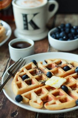 Whole Wheat Lemon Blueberry Waffles, these Waffles are packed with juicy blueberries and fresh lemon zest for the perfect light summer breakfast recipe! | joyfulhealthyeats.com #brunch #mothersday