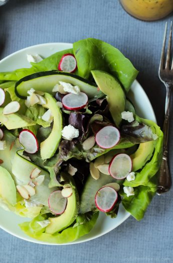 A simple fresh Summer salad that takes 5 minutes - Avocado Butter Lettuce Salad filled with spicy radishes, almond slices, goat cheese, and topped with a Lemon Vinaigrette. | joyfulhealthyeats.com #recipe #glutenfree #vegetarian