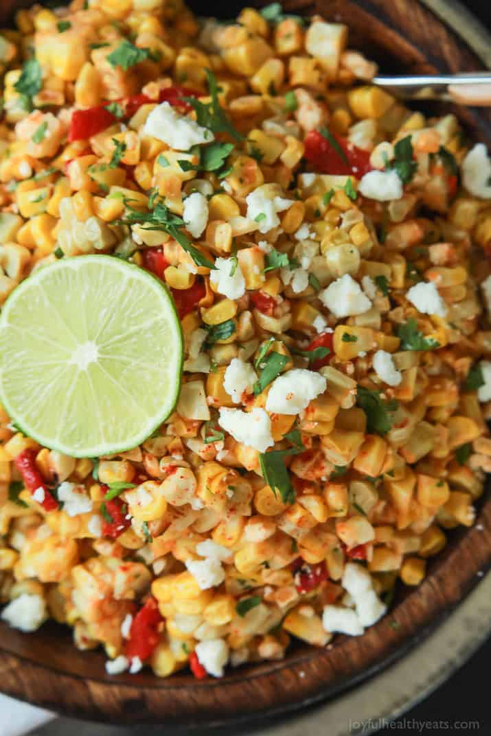 Grilled Sweet Corn Salad filled with cilantro, lime, peppers, and queso fresco in a bowl