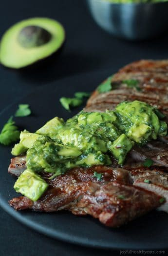 Juicy Grilled Flank Steak topped with a fresh Avocado Chimichurri, done in 15 minutes - it's grilling made simple but still full of flavor! De-lish! | joyfulhealthyeats.com #recipes #paleo #glutenfree Easy Quick Dinner Ideas