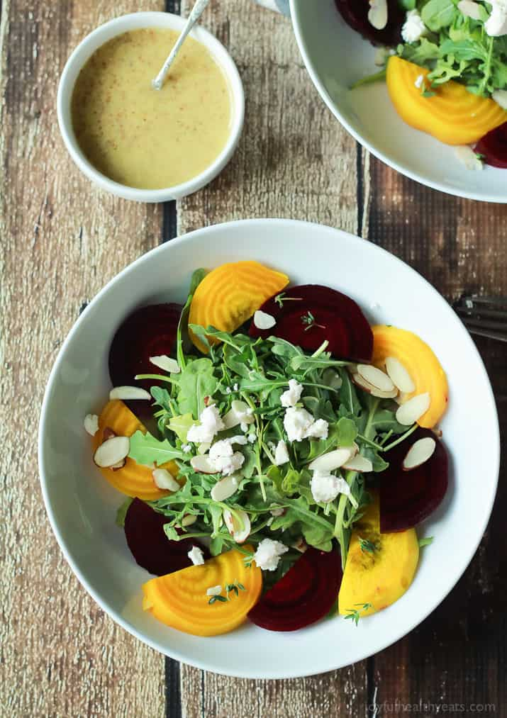 Beet Arugula Salad with sliced almonds, fresh thyme, and creamy goat ...