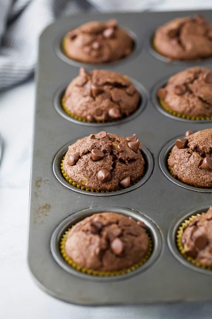 a photo of the best skinny double chocolate banana muffins in a muffin tin