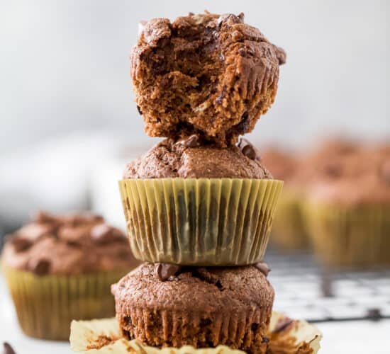 skinny double chocolate banana muffins stacked in a tower