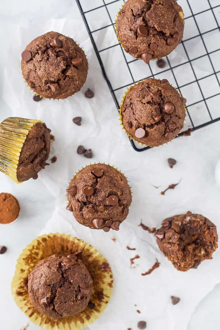 overhead photo of the best skinny double chocolate banana muffins scattered on a board