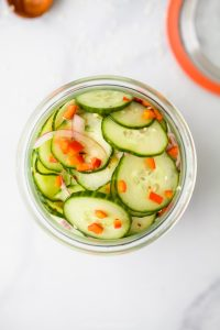 10 Minute Easy Asian Cucumber Salad Recipe (Dairy Free) in a big glass jar