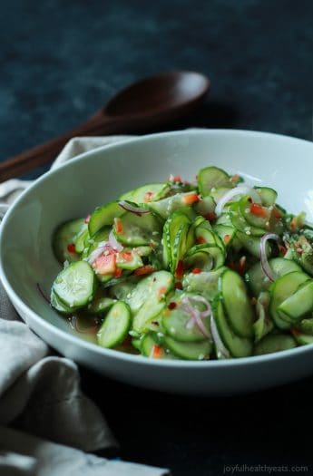 An easy to make Asian Cucumber Salad that's full of crunchy cucumber, rice wine vinegar, and a few secret ingredients! Can be served as a refreshing summer salad or the condiment to a sandwich!   joyfulhealthyeats.com Easy Healthy Recipes