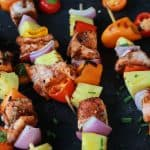 Caribbean Grilled Salmon Kabobs will take you straight to the islands with the cajun spices, fresh pineapple, bell peppers, and fresh seafood! Perfect healthy grilling recipe for the summer done in 20 minutes! | joyfulhealthyeats.com #recipes Easy Healthy Recipes