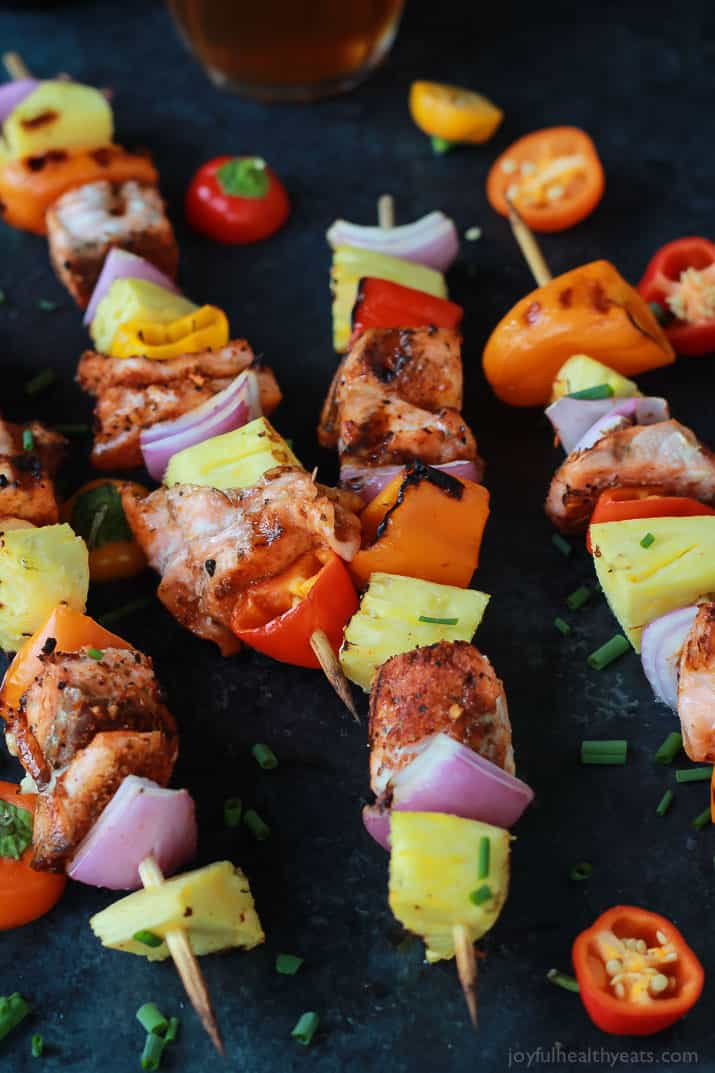 Caribbean Grilled Salmon Kabobs with cajun spices, fresh pineapple, bell peppers, and fresh seafood