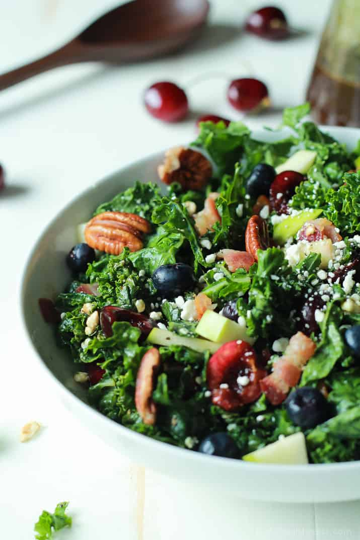Summer Kale Salad with fresh cherries and blueberries, pecans, bacon and feta in a serving bowl