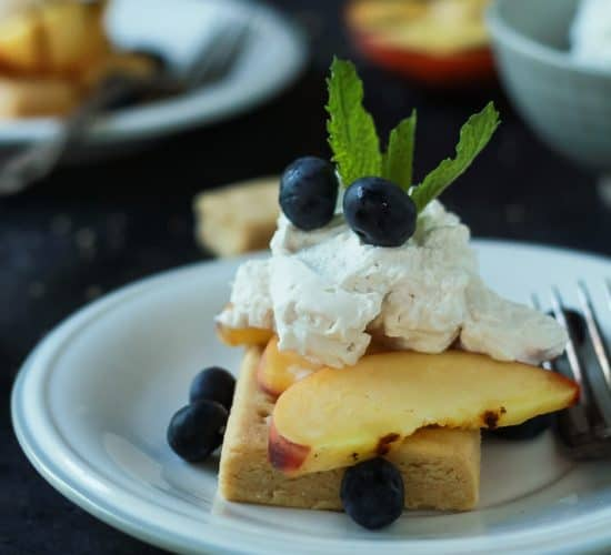 This Grilled Peach Shortcake is a fun twist on a classic strawberry shortcake recipe. Filled with buttery shortbread, grilled peaches, and coconut whipped cream - a sure winner this summer! | joyfulhealthyeats.com #recipes #summer #ad Easy Healthy Recipes