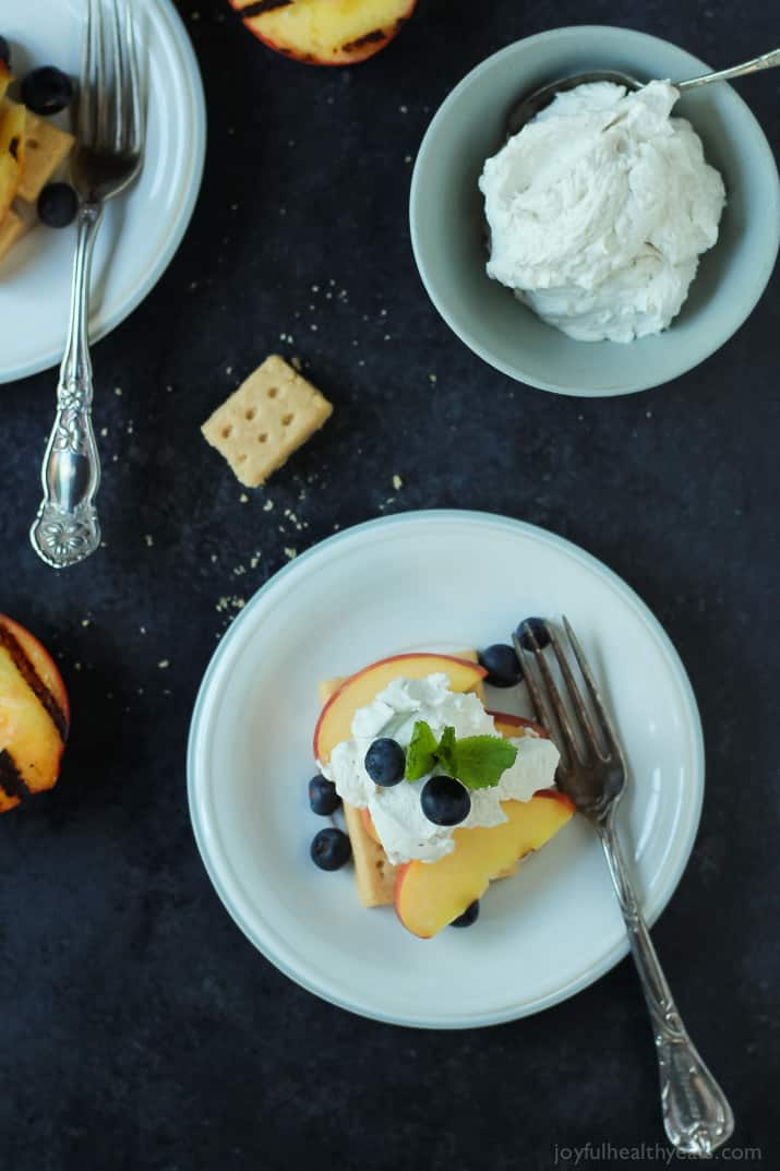 Top view of a serving of Grilled Peach Shortcake on a plate with fresh blueberries