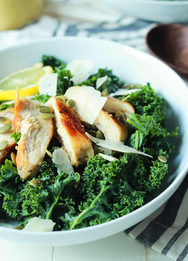 Easy Kale Chicken Caesar Salad with pepitas, shaved parmesan and a homemade egg and anchovy free Caesar Dressing! Its the perfect salad recipe to have for the summer! | joyfulhealthyeats.com Easy Healthy Recipes