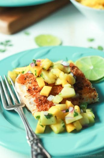 Pan Seared Cajun Mahi Mahi with a fresh Mango Pineapple Salsa, an easy gluten free recipe that takes 15 minutes to make! A taste of the Caribbean! | joyfulhealthyeats.com #recipes Easy Dinner Recipes