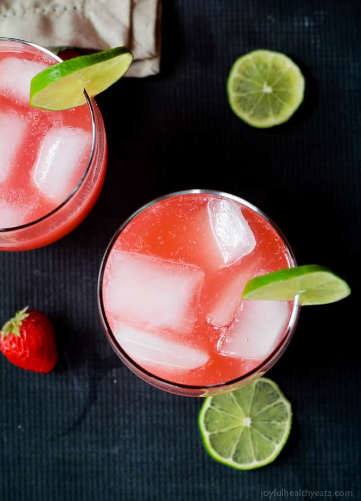 Top view of two glasses of Fresh Strawberry Limeade