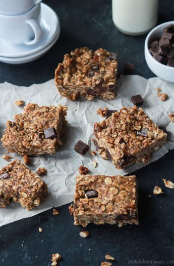 Breakfast never tasted so good with these No Bake Peanut Butter Chocolate Bars, done in 5 minutes! Filled with chocolate chunks, creamy peanut butter, chia seeds, and loads of other nutrients to fill you up! | joyfulhealthyeats.com #recipes Easy Healthy Recipes