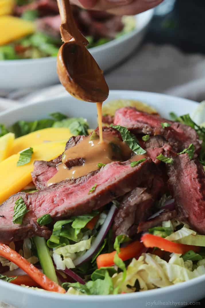 Thai Steak Salad is filled with loads of vegetables, grilled steak, and then topped with a Spicy Peanut Dressing, all in 20 minutes and only 376 calories! I call that a win! | joyfulhealthyeats.com #recipes #30minutemeal