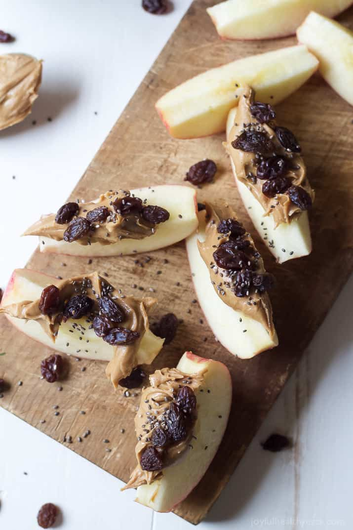 Easy Apple Peanut Butter Energy Bites, a perfect after school snack for the kids or mid day pick me up on a busy workday. These Energy Bites are loaded with peanut butter and nutrients for one delicious bite! | joyfulhealthyeats.com #chiaseeds #recipes