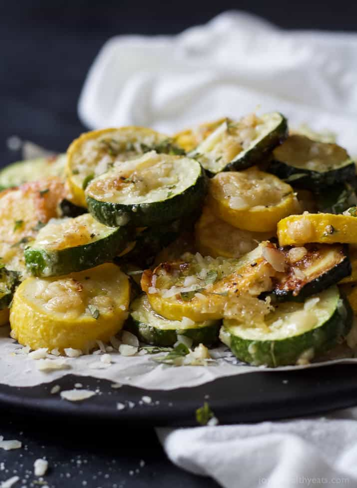 Close-up of Crispy Parmesan Garlic Zucchini Chips on parchment paper