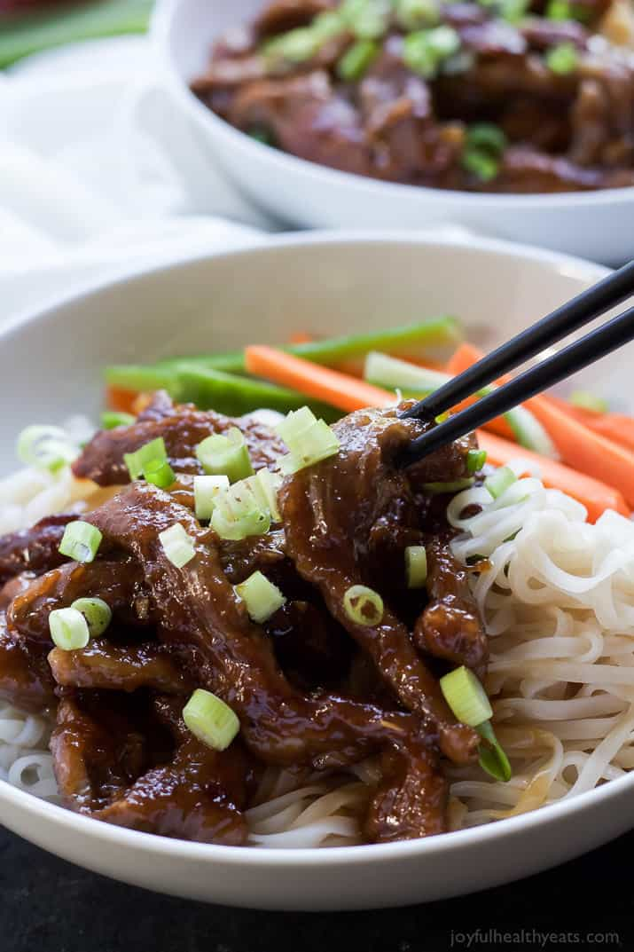 Forget the take out, make this healthy low calorie 30 minute Honey Sriracha Mongolian Beef Recipe with Rice Noodles. It's sweet, spicy, and perfect for a fast weeknight meal! | joyfulhealthyeats.com #recipes