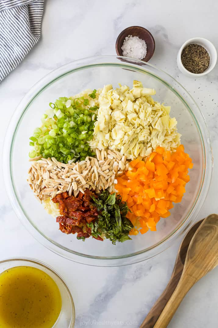 A Bowl Filled with Slivered Almonds and Prepared Veggies for Orzo Salad