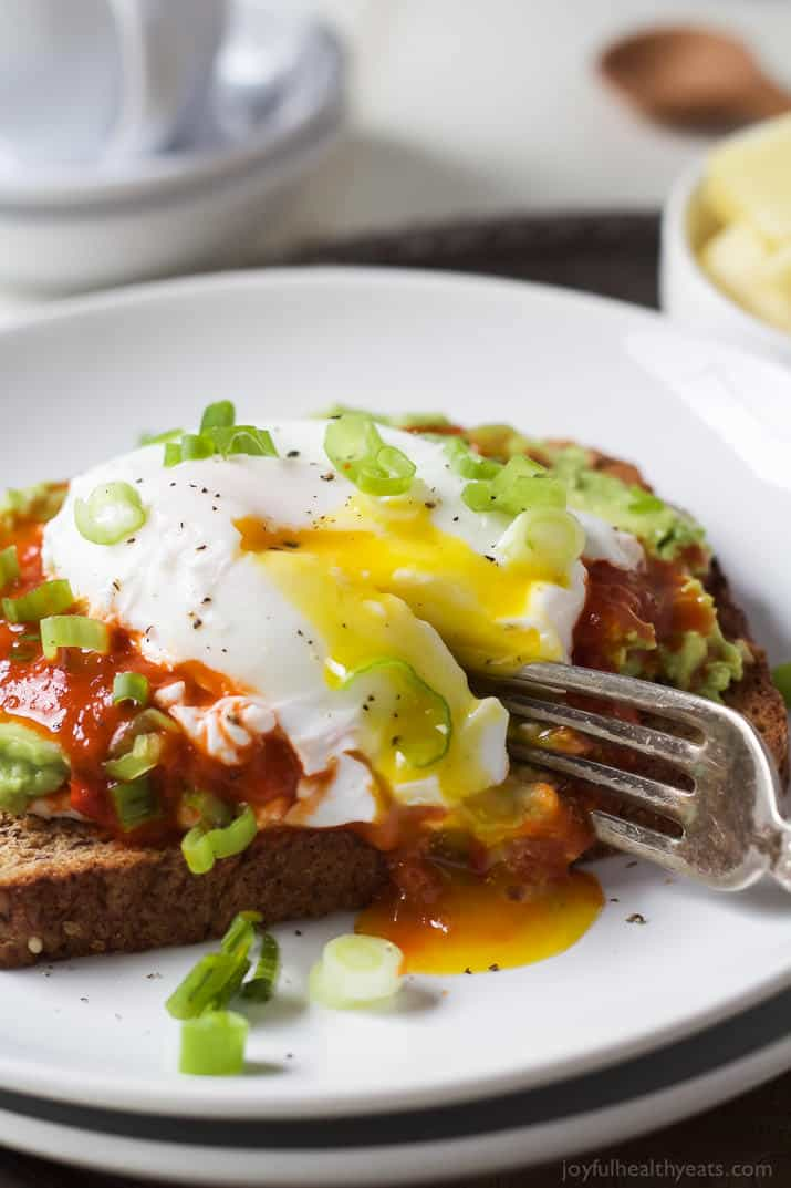 Ricotta Avocado Toast topped with Harissa and a Poached Egg, a heart healthy breakfast packed with protein and full of flavor for only 269 calories a serving! | joyfulhealthyeats.com #recipes