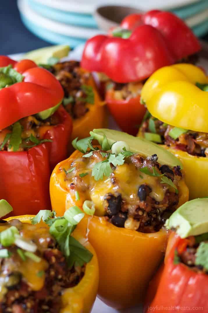 Southwestern Turkey Quinoa Stuffed Peppers filled with loads of protein and bold flavors that will leave you feeling satisfied and hungry for more all at the same time! Only 262 calories a serving! | joyfulhealthyeats.com #recipes