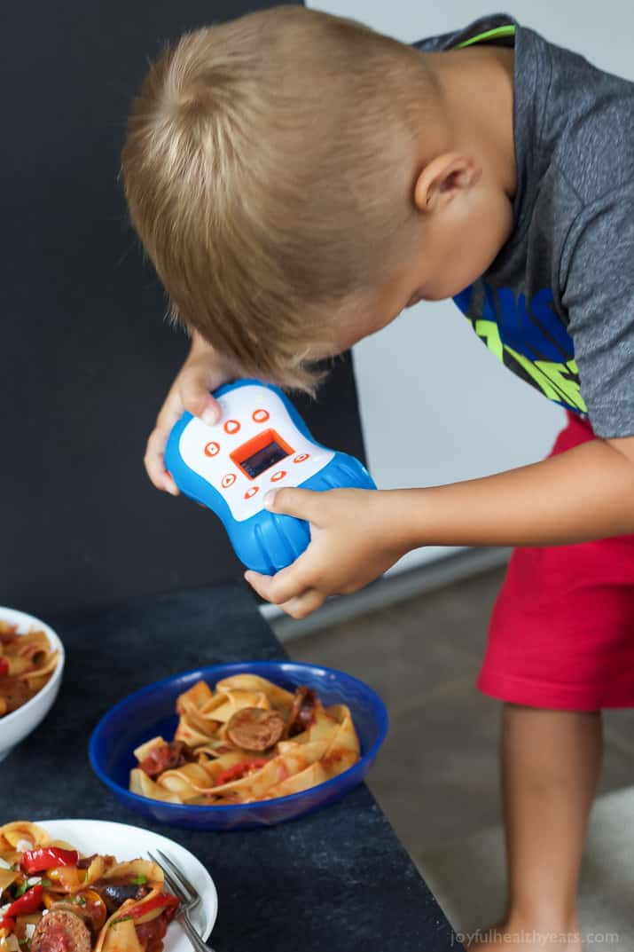 Image of Cason Photographing Tomato Pappardelle Pasta with Italian Sausage