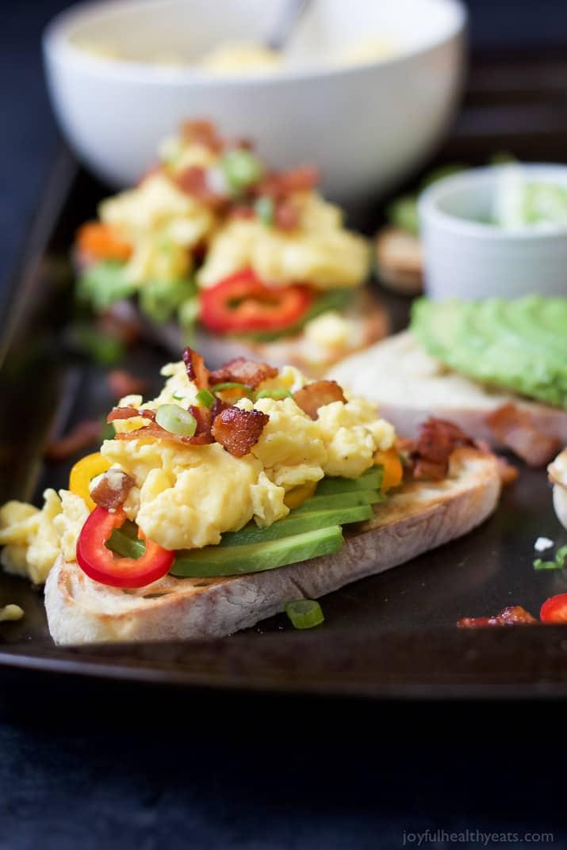 Two Servings of Breakfast Bruschetta Avocado Toast on a Baking Sheet