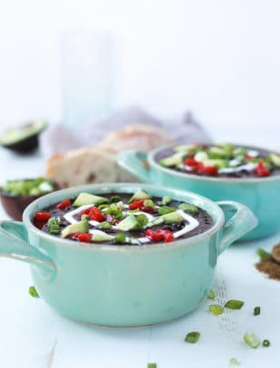 A gluten free Crock Pot Black Bean Soup with a smokey southwestern twist then topped with tangy greek yogurt for the ultimate savory bite. Believe me, you'll want to cozy up with a bowl of Black Bean Soup every night after trying this! | joyfulhealthyeats.com #vegetarian #recipes