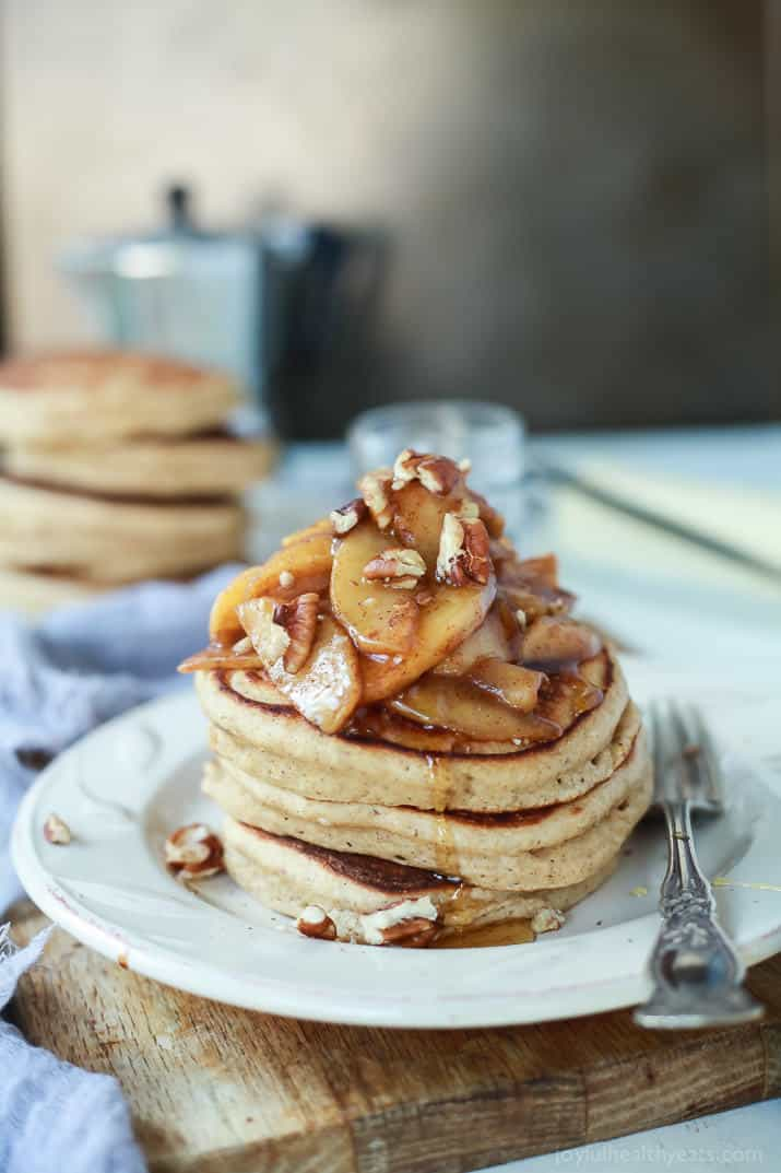 A stack of Fluffy Whole Wheat Pancakes topped with Cinnamon Apple Compote