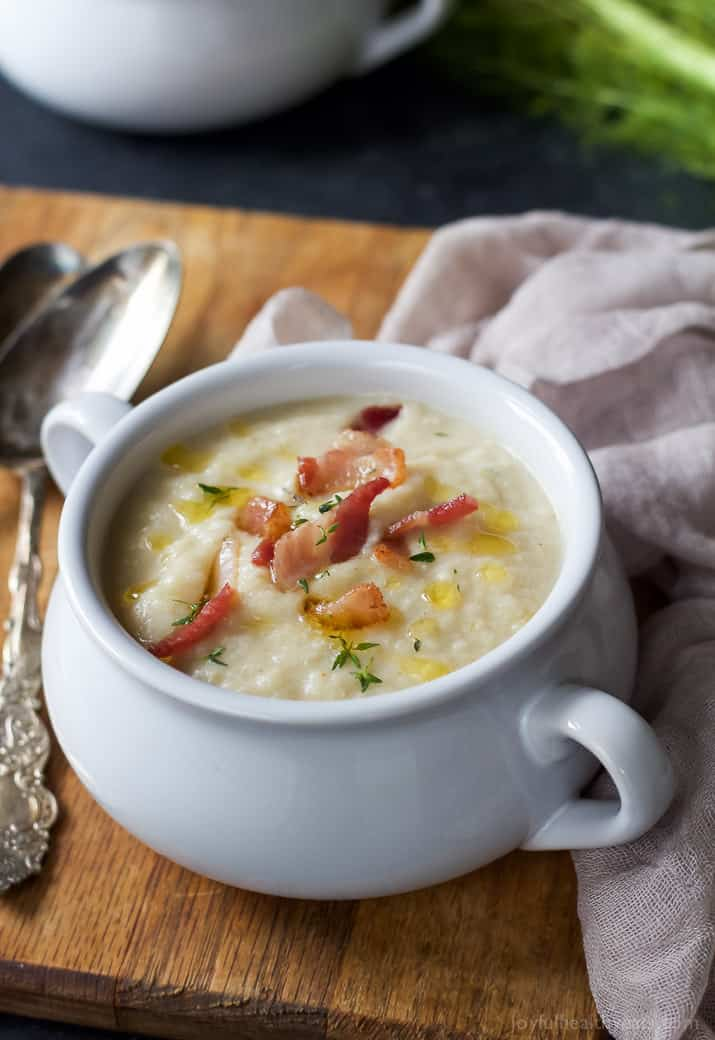 This creamy Roasted Fennel Cauliflower Soup will be the star of the fall! Packed with rich flavor then topped with chili infused oil and crispy bacon -only 156 calories a serving! | joyfulhealthyeats.com Easy Dinner Recipes