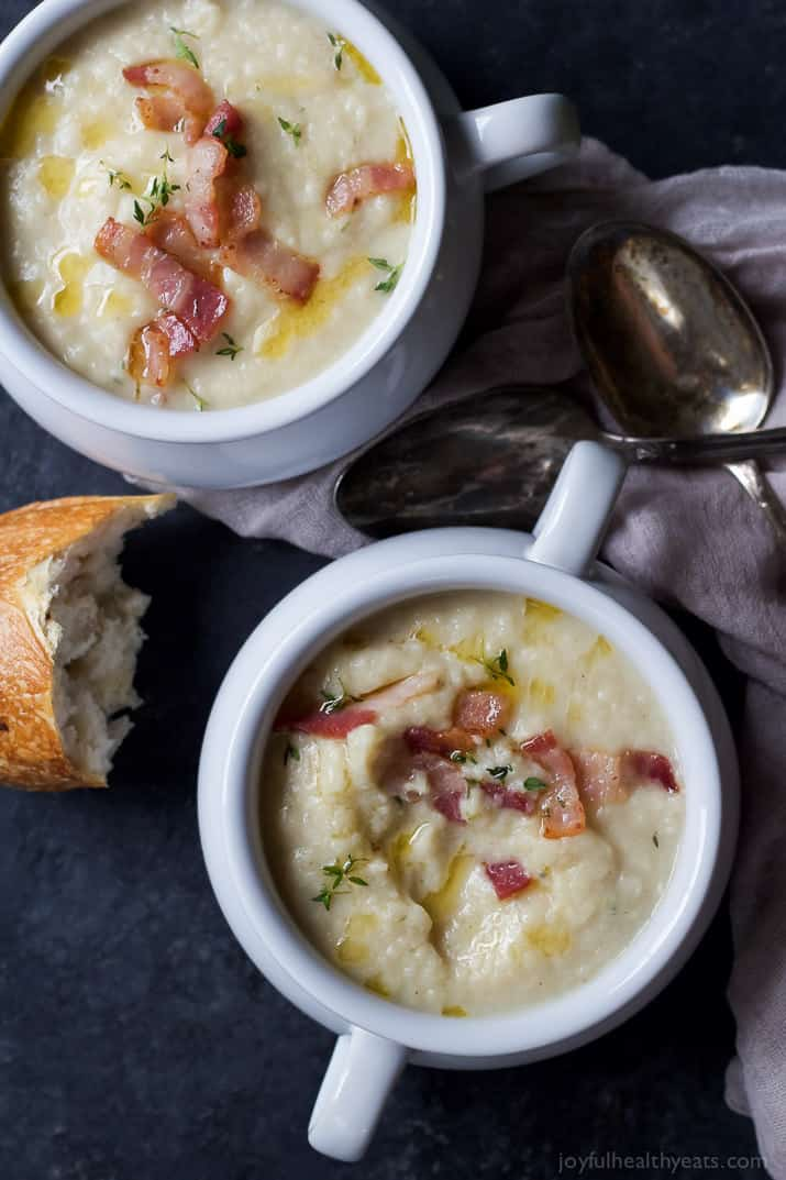 This creamy Roasted Fennel Cauliflower Soup will be the star of the fall! Packed with rich flavor then topped with chili infused oil and crispy bacon -only 156 calories a serving! | joyfulhealthyeats.com