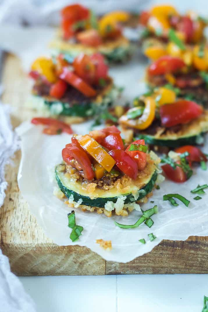 Skinny Bruschetta Zucchini Chips a low calorie, meat free, and dairy free, option for game day but still packs a punch of flavor from a few secret ingredients! This is a must try for sure!   joyfulhealthyeats.com #recipes #ad #MeatlessMondayNight
