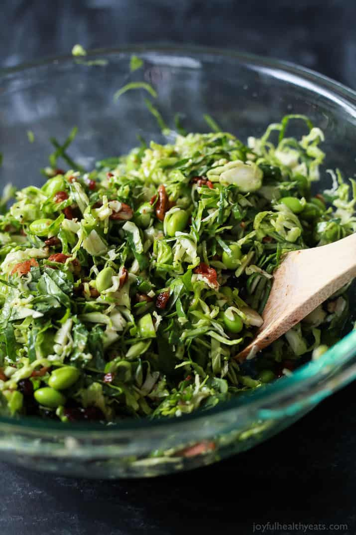 Autumn Kale & Shaved Brussel Sprout Salad ingredients in a mixing bowl