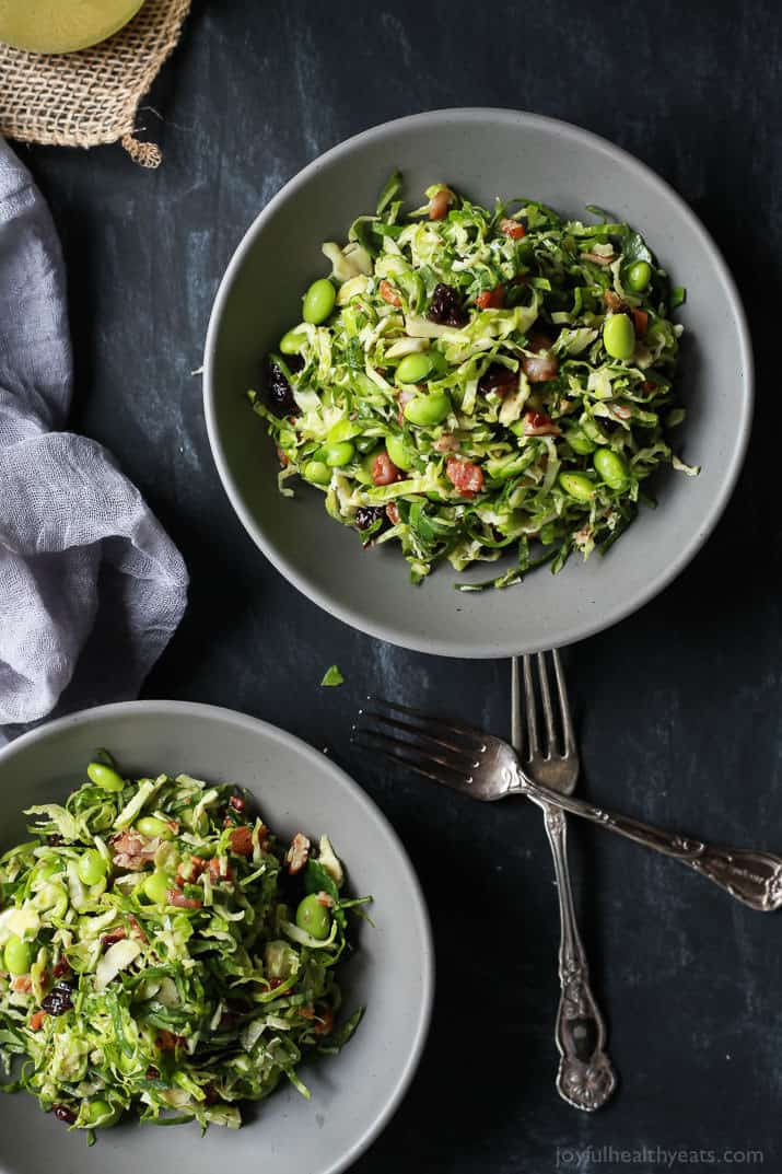 Autumn Kale & Shaved Brussel Sprout Salad in bowls
