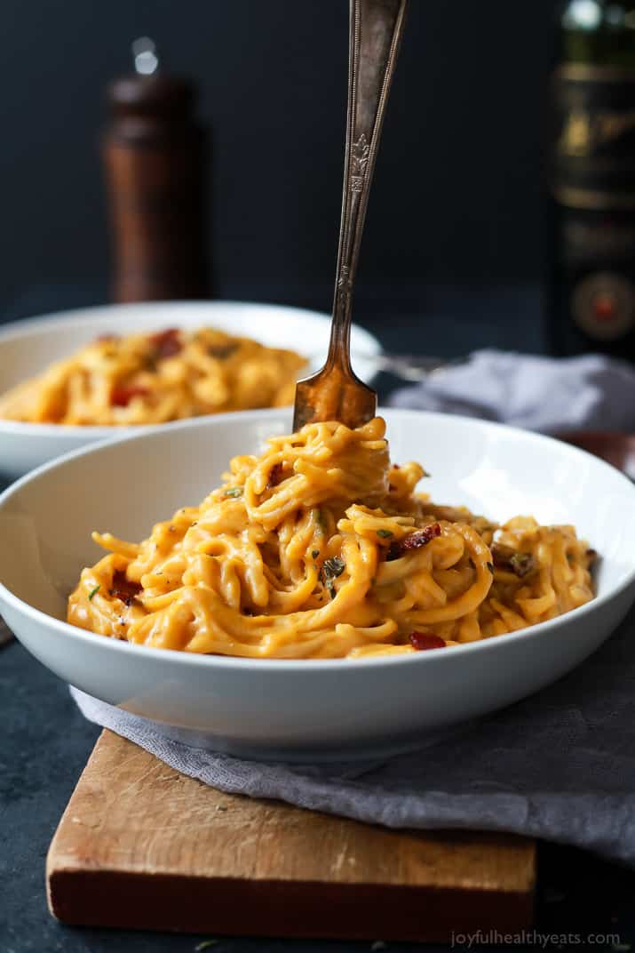 Creamy Butternut Squash Alfredo Pasta permeated with fresh sage and thyme then perfected with a garnish of salty bacon on top! The fall recipe is silky smooth, luscious, healthy and absolutely addicting.   joyfulhealthyeats.com #glutenfree #fall