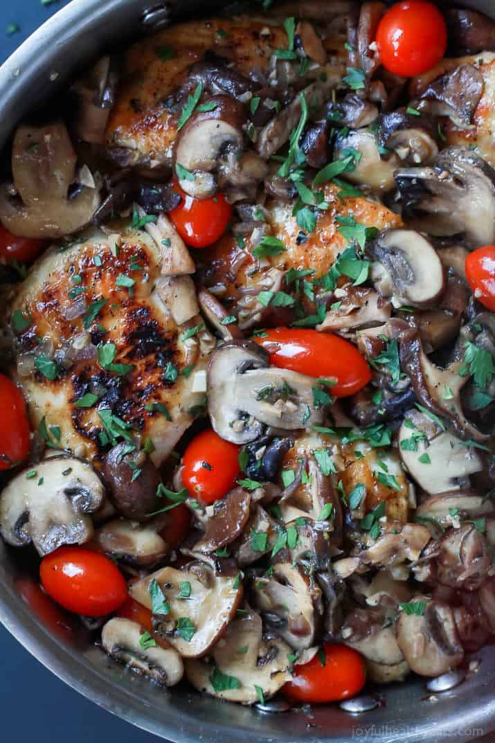 Close-up of Chicken Marsala with blistered tomatoes in a skillet