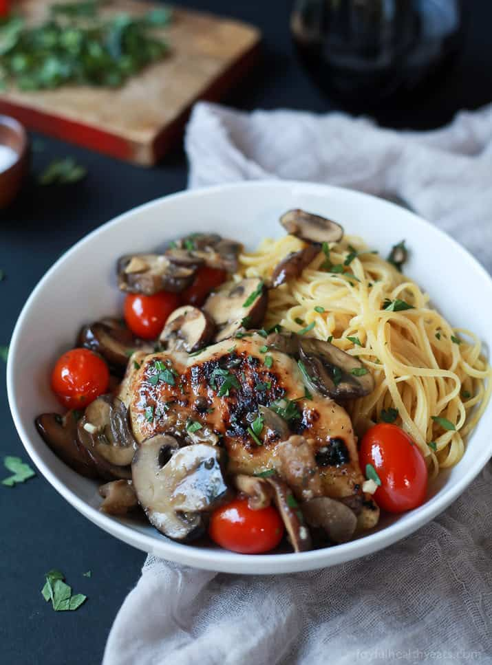 Chicken Marsala topped with Blistered Tomatoes and served over pasta in a bowl