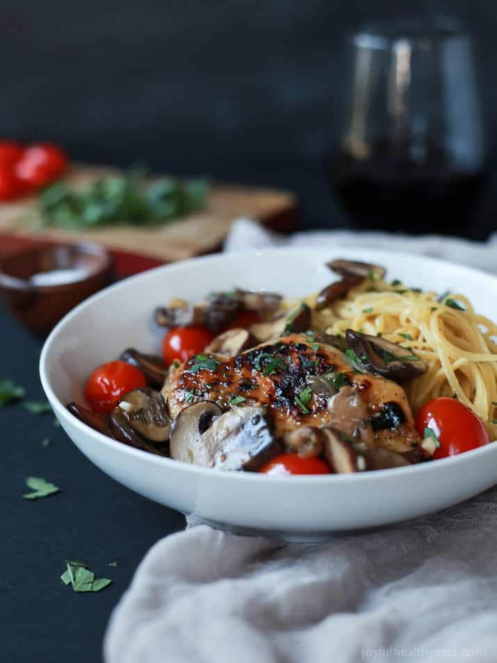 Chicken Marsala topped with Blistered Tomatoes served over pasta in a bowl