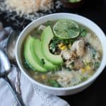 Not your momma's chili! An Easy Crock Pot White Chicken Chili filled with southwestern flavors that will tease your taste buds. Plus a surprise easy cooking method for chicken! | joyfulhealthyeats.com