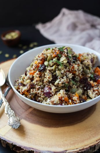 The BEST Roasted Butternut Squash Quinoa Salad with a secret creamy element and surprise spice that makes this salad dish pop with flavor. This Quinoa Salad is a rock star gluten free vegetarian recipe you need on your table this fall. | joyfulhealthyeats.com #recipes Easy Dinner Recipes