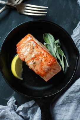 Salmon with Sage Brown Butter Sauce in a cast iron skillet